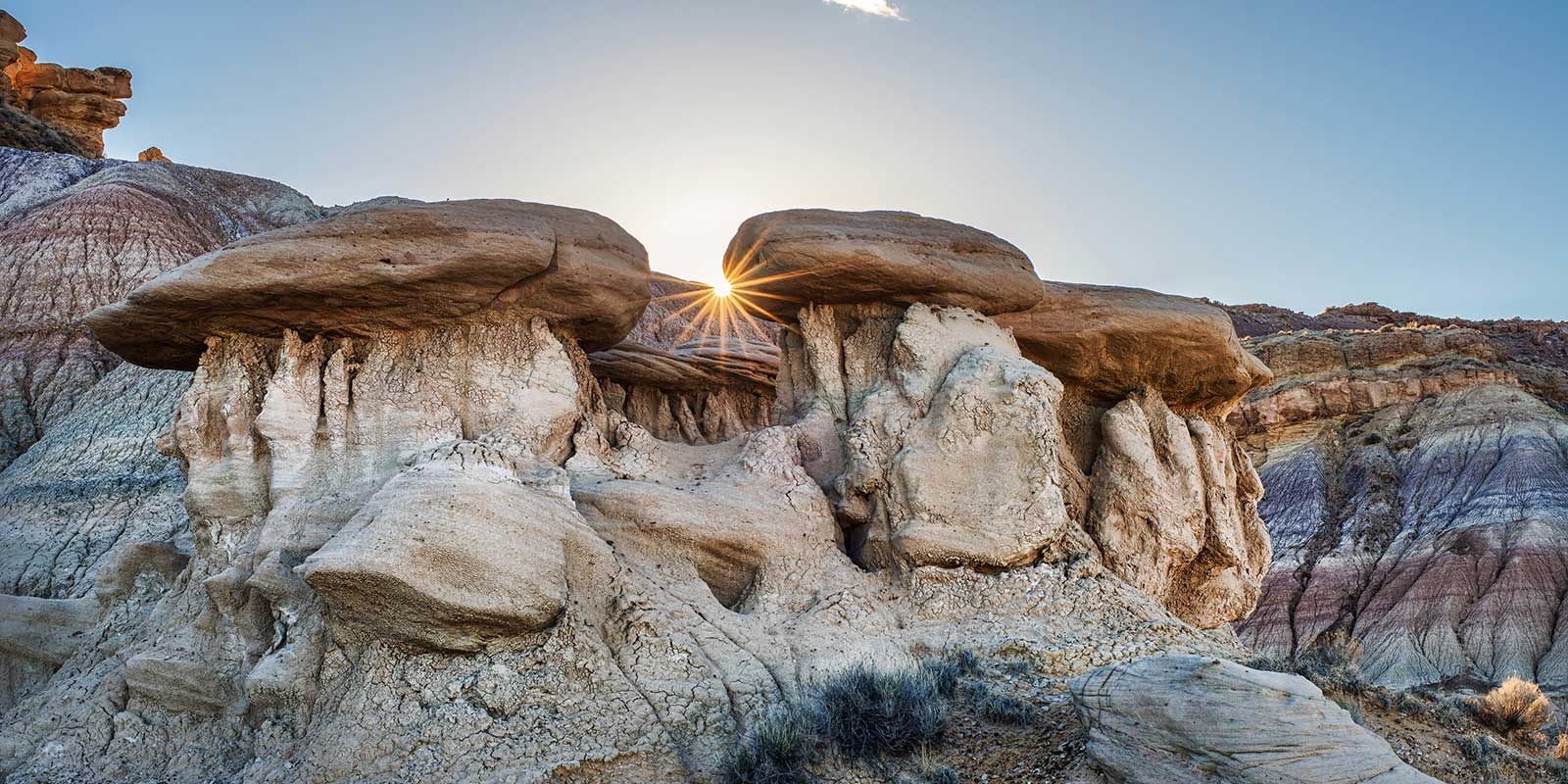 Sunburst shining through Petrified Forest formations | Photo courtesy of Andrew V. Kearns